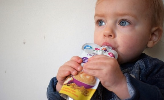 Baby Eating From Food Pouch