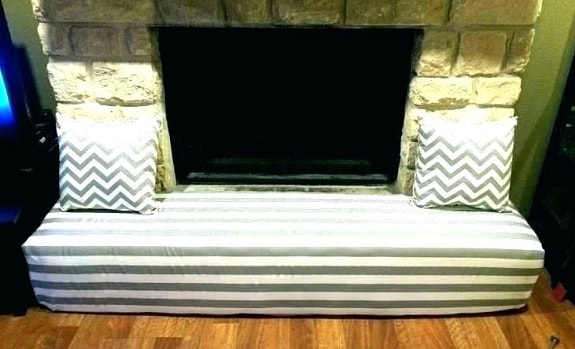 Baby Proofed Fireplace Hearth Using Bench Cushion