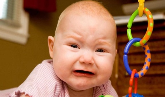 Baby With Painful Looking Face