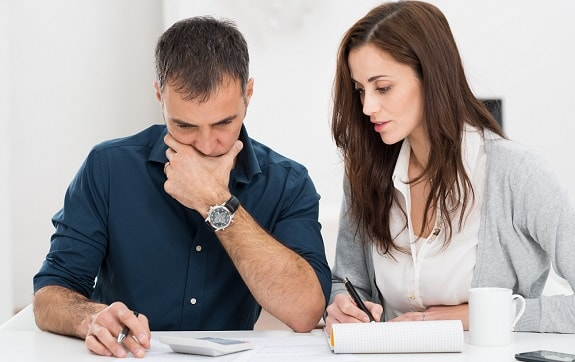Expecting Couple Preparing Budget