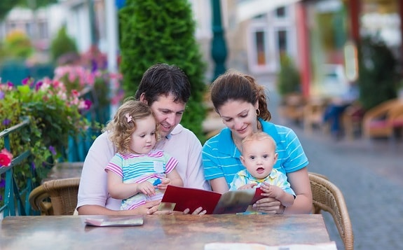 Family With Baby Dining Outside Restaurant