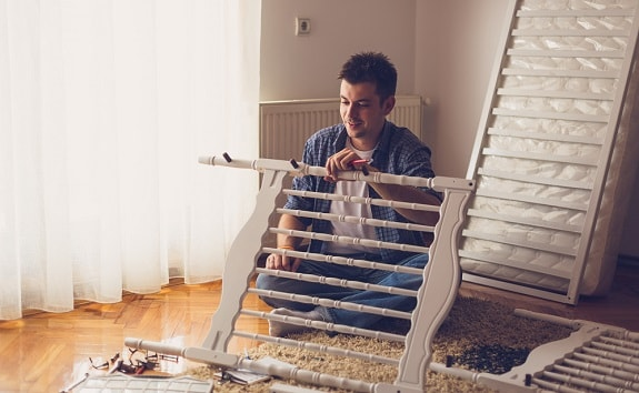 Father Assembling Baby Crib