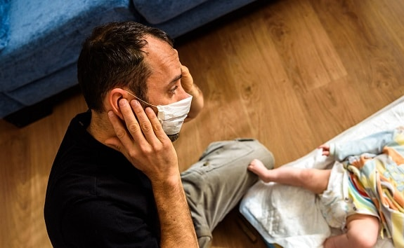 Father Wearing Mask Around Gassy Baby