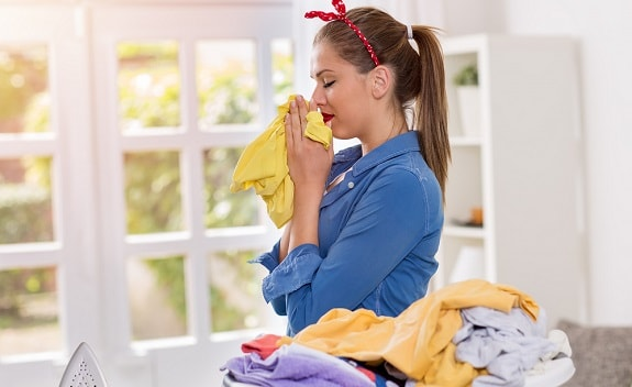 Mother Smelling Clean Cloth Diapers