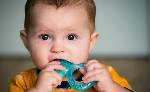 Teething Baby Chewing on Ring