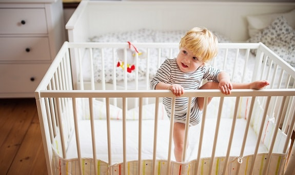 Toddler Trying to Climb Out of Crib