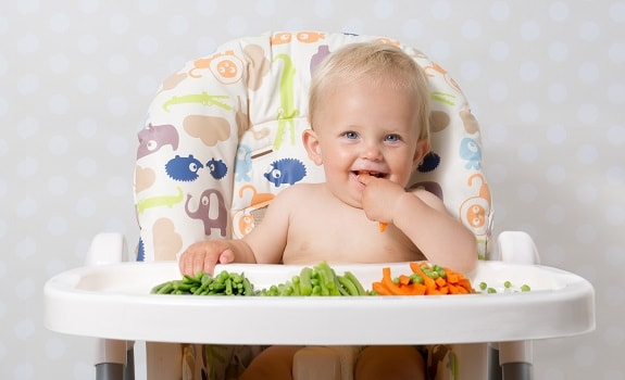 Baby Learning to Chew Vegetables