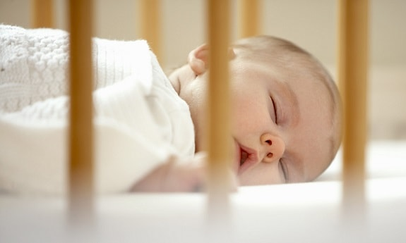 Baby Sleeping in Crib During the Day