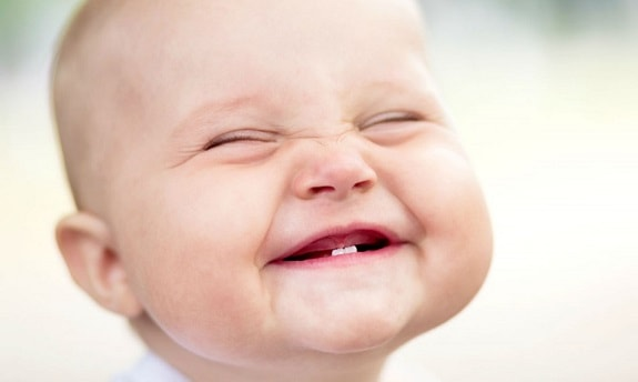 Baby Smiling Showing Baby Teeth