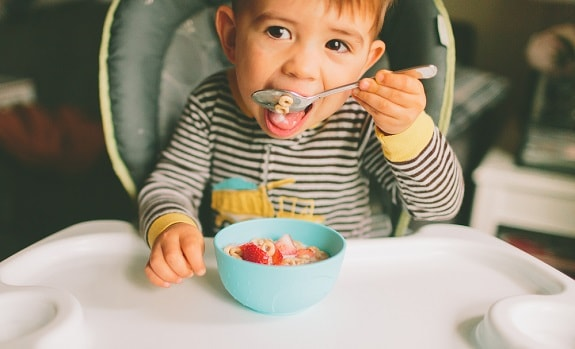 Toddler Eating Cereal With Mouth Open
