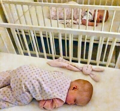 Twins Sleeping Separate Parallel Cribs